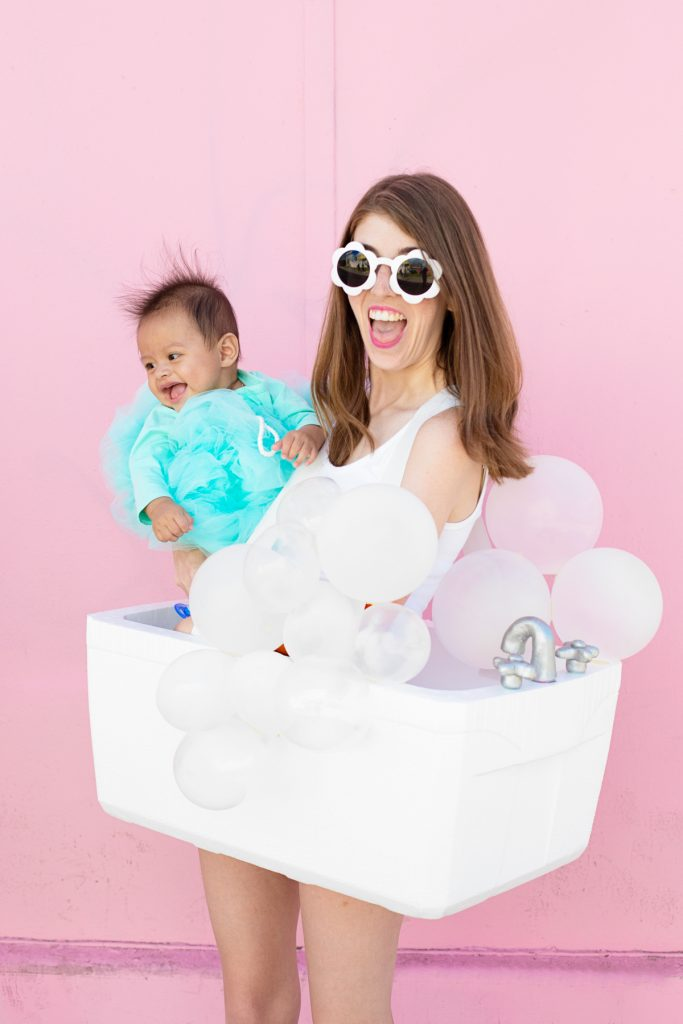 Mom and her baby dressed as a bubble bath and loofah