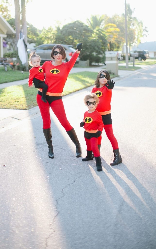 Mom, her baby, and other two kids dressed as the Incredibles