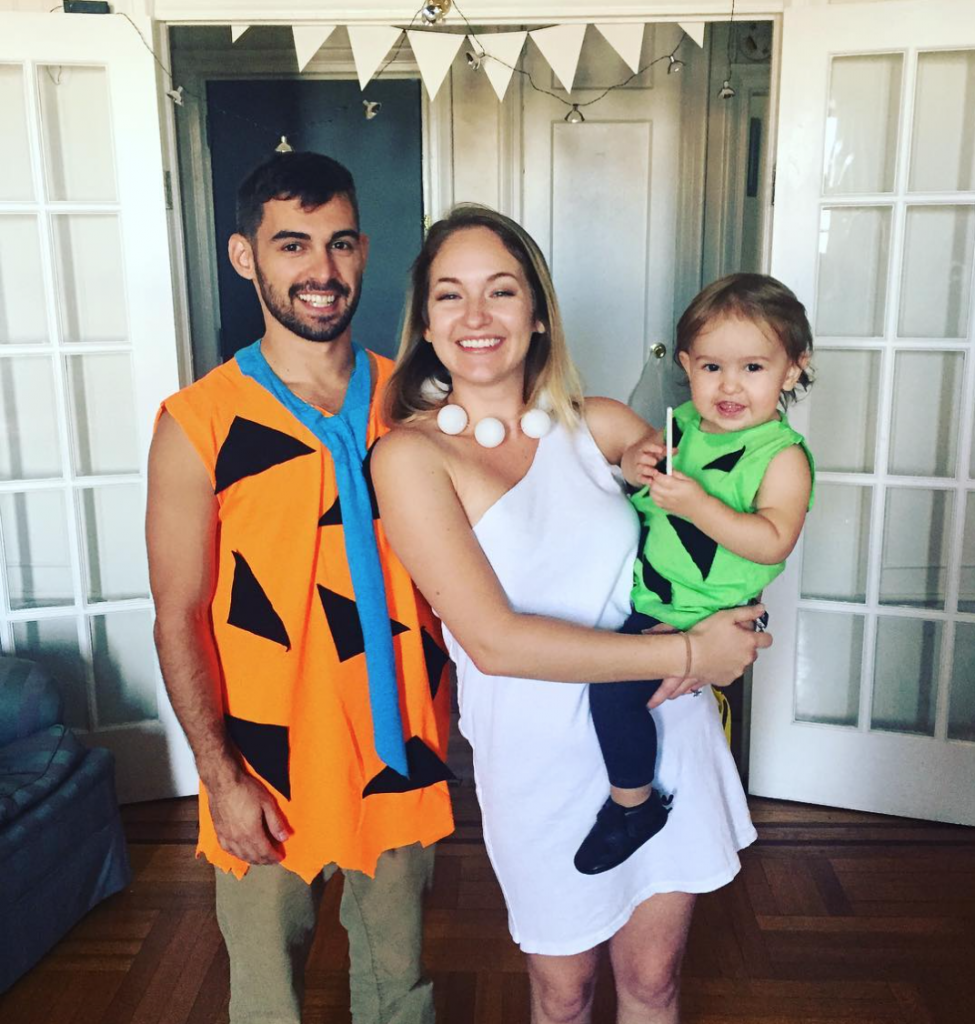 a couple and their baby dressed as the Flinstones