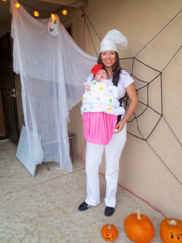 Mom and her baby dressed as a baker and a cupcake