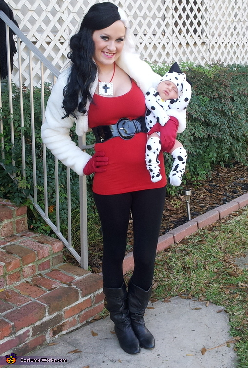 Mom and her infant dressed as Cruella de Vil and a dalmation