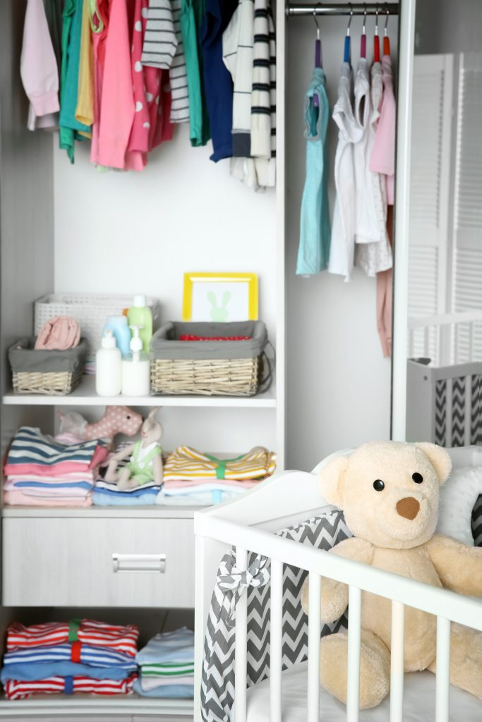 Organized nursery with closet and crib